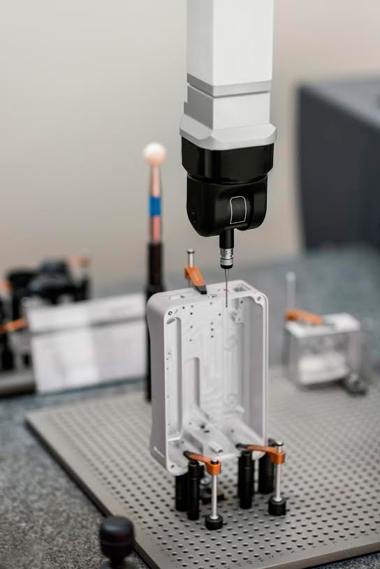 A CNC milling machine producing product.